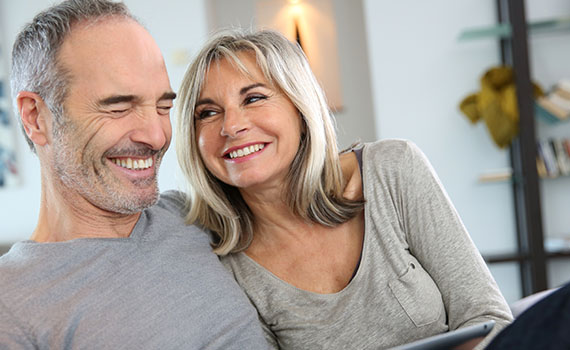 Mature couple smiling at home